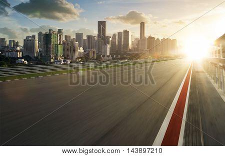 Motion blurred racetrack , morning scene .