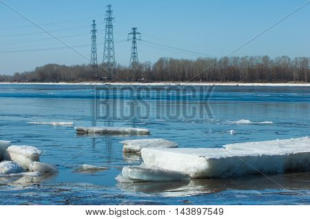 River With Broken Ice.energy Pillars.  Ice Hummocks On The River In Spring.