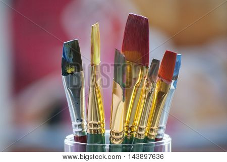 A colourful and detailed photo of paint brushes