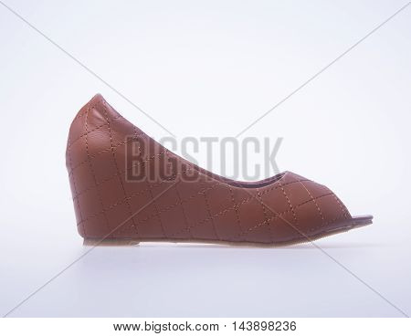 Shoe. Brown Colour Fashion Woman Shoes On A Background.