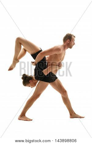 Paired gymnastics. Man and girl perform support, isolated on white
