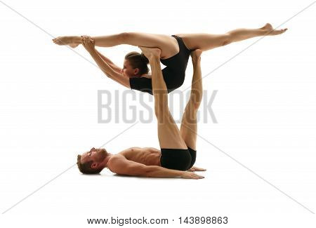 Paired acrobatics. Man and woman doing gymnastic splits in support
