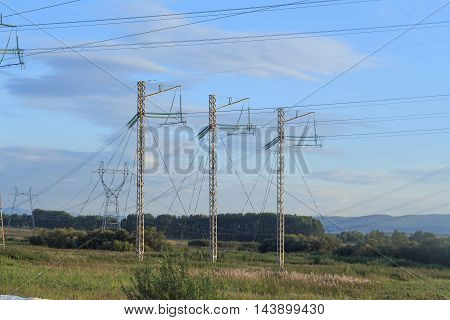 Electric high voltage poles on the plain side view