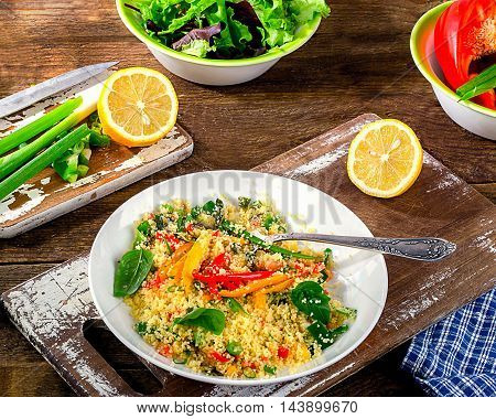 Couscous With Vegetables On Wooden Background.