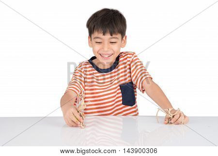 Little boy playing dinosaur fossil toy on the table