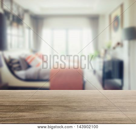Wooden Table Top With Blur Of Modern Bedroom Interior