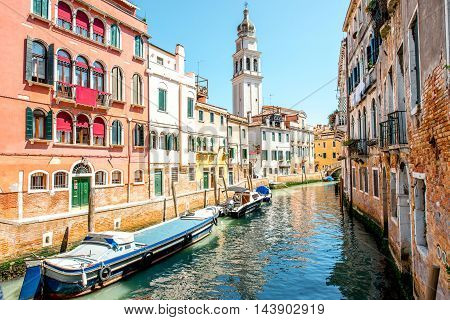 Small romantic water canal with Saint Antonin church in Castello region in Venice