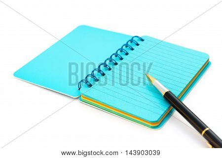 pen and colorful notebook on white background