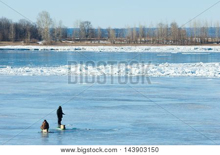 River Flood Fishermen. Torn River Ice Fishermen. River With The Last Ice Fishermen On The Ice.