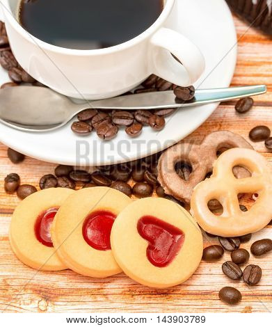 Mug Of Freshly Brewed Coffee And Heart Cookies