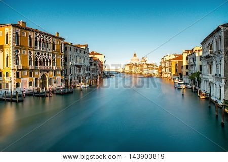 View on Grand canal with Santa Maria basilica from Accademic bridge in Venice. Long exposure image technic