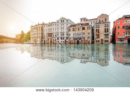 Venice cityscape view on Grand canal with beautiful buildings on the sunset. Long exposure image technic with reflection on the water