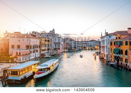 View on illuminated Grand canal with from Accademic bridge at the dusk in Venice.