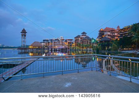 Landscape of modern buildings by the lakeside with jetty in Putrajaya Malaysia during twilight