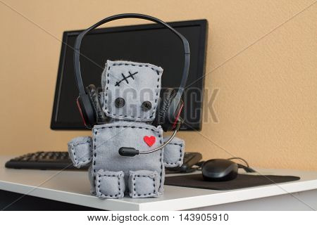 Soft Robot Toy With Headset at Call Center.
