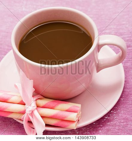 Mug Of Freshly Brewed Coffee And Some Strawberry Cookie Sticks