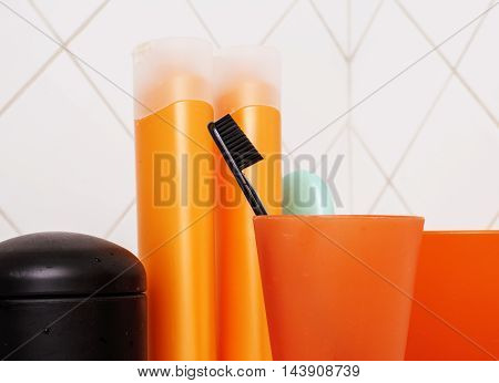usual stylish stuff in bathroom, shampoo, accessories, black  toothbrush, casual normal real background close up