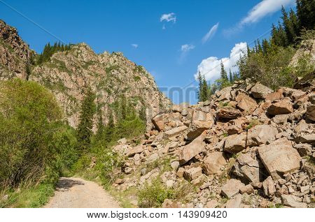 Kazakhstan, The Tien Shan Mountains. Trans-ili Alatau. High Plateau Assy. The Rock Above The Road, I