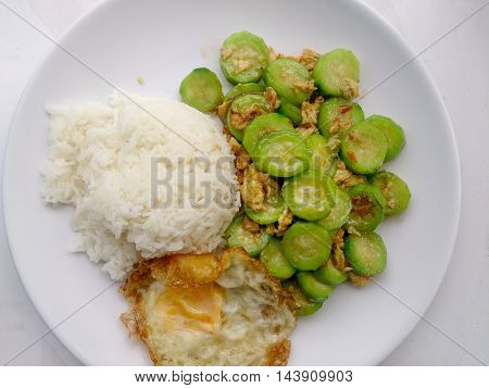 Stir Fried Zucchini With Egg With Rice On White Dish With White Background. Vegetarian Food & Health