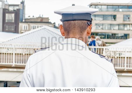 captain looking over his ship near the port of Antwerp