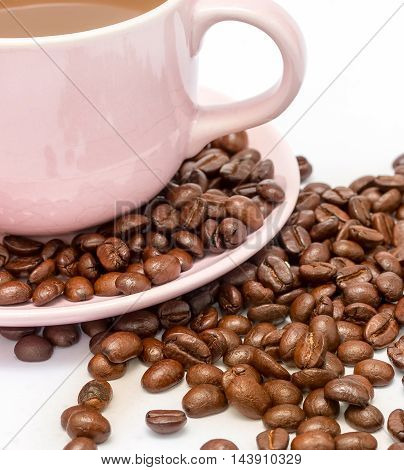 Coffee Beans Next To A Cup Of Freshly Brewed