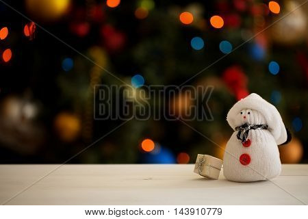 White Snowman on a Christmas tree background