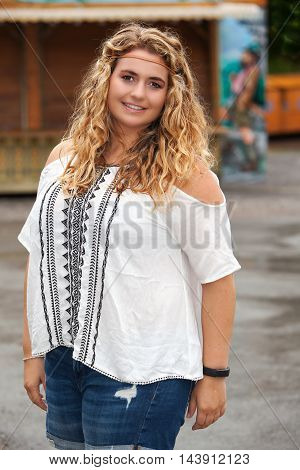 Shot of a beautiful blond plus-size model in summer clothes