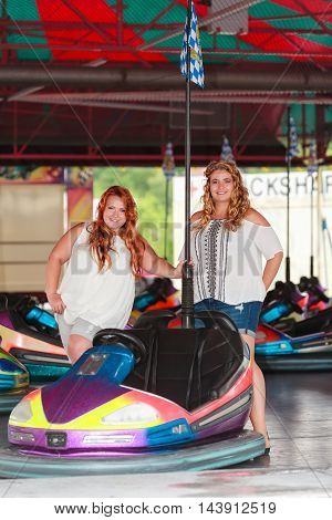 Two Plus Sizes Models in summer clothes during festival