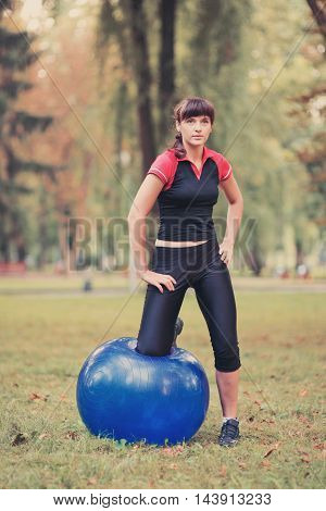 A Young Woman Engaged In Fitness Outdoors