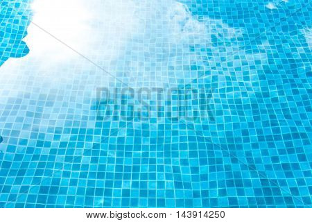 Blue Tiled Swimming Pool Background. View From Eye