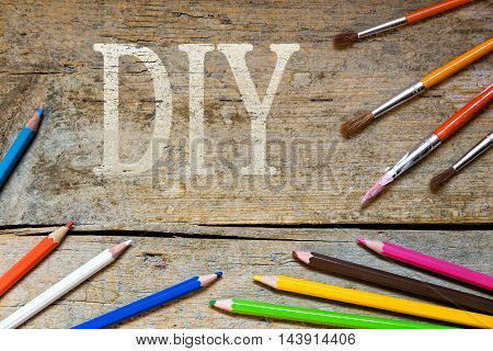 Wooden Background With The Word Diy