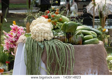 a fresh crop of cucumbers and peppers are in a large pile on the table