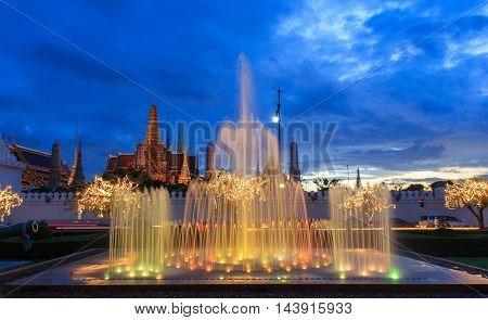 Close up fountain at night light landmark of Sanam Luang and Emerald Buddha Temple (Wat Phra Kaew) background Bangkok Thailand