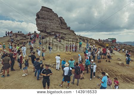 Bucegi Mountains Romania - August 6 2016: Thousands of tourists come to visit the Sphinx the mythical megalith with human face resemblance located at 2216 m altitude on Bucegi Mountains plateau.