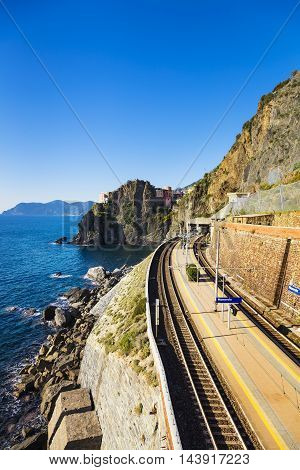 Manarola village train or railroad station rock and sea. Five lands Cinque Terre National Park Liguria Italy Europe.