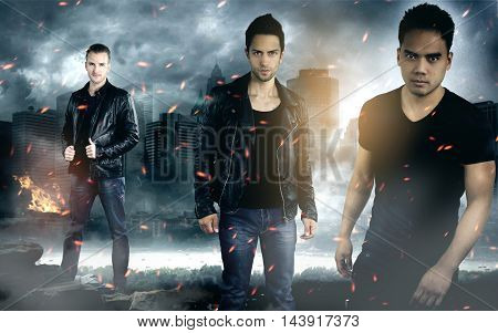 three fashion men wearing leather jackets in front of a destroyed city