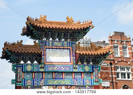 China Town London England United Kingdom - August 16 2016: Large Ornate Arch marking Entrance to London's Chinatown