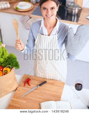 Woman making healthy food standing happy smiling in kitchen
