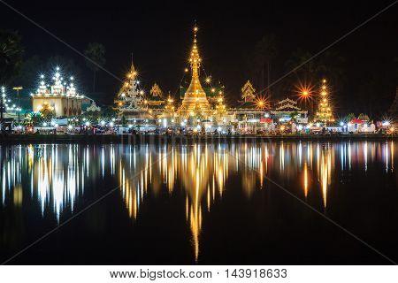 Wat Jong Klang in dark night and reflection at Maehongsonprovince North of Thailand