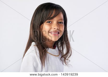 cute young child portrait in studio isolated on white background