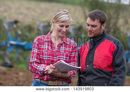Couple of farmers discussing about to do list