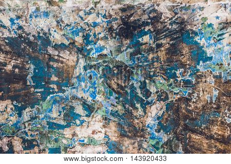 Old grungy vintage weathered background texture. Retro stained painted aged surface.