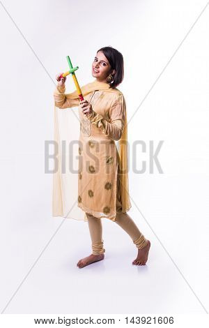 Indian beautiful young girl with garba sticks on Indian Festival Navratri, isolated on white background