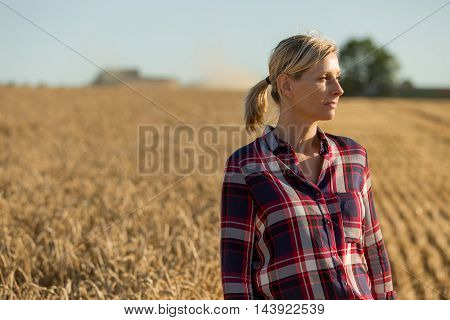 Portrait of beautiful female farmer in summer