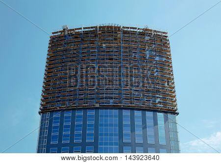 Volgograd Russia - May 3 2009: Office building under construction. Building scaffolding