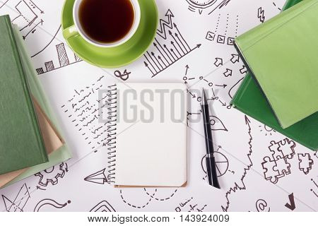 Office table desk with supplies, notepad, computer and coffee cup. Business creative concept.