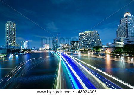 Beautiful night city bangkok with speed light on river