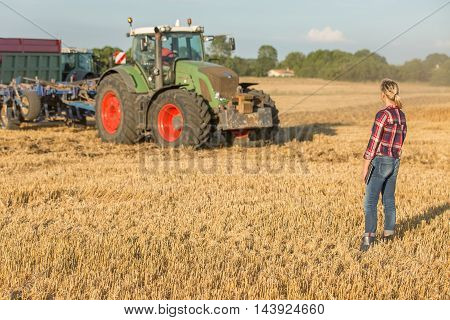 portrait of female farmer with her tractor