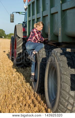 female farmer with tractor in her wheat fields