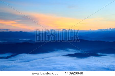 Layer of mountains in the mist at sunrise time